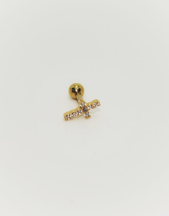 Piercing en acero inoxidable con forma de cruz y circonitas blancas. Chapado en oro.
