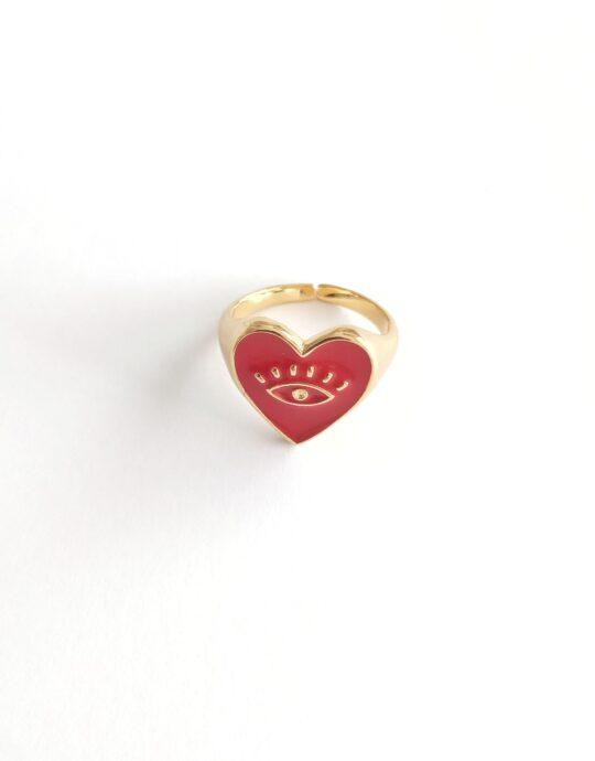 Anillo ajustable en acero inoxidable con forma de corazón con ojo en color rojo. Bañado en oro.